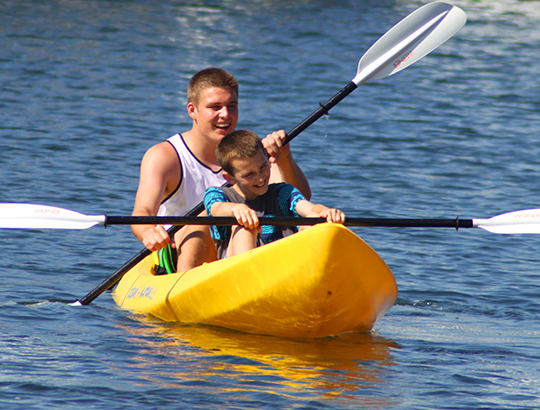 Brothers kayaking on Mission Bay with watercraft rented from Action Sport Rental