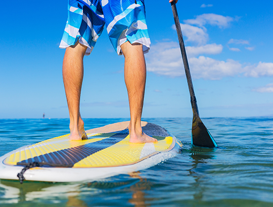 Stand-up paddle boarding on SUPs rented from Action Sport Rental at the Bahia Resort Hotel