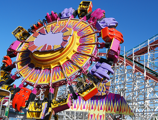 Power forward, backward and upside down while rotating around on the Control Freak ride at San Diego's Belmont Park