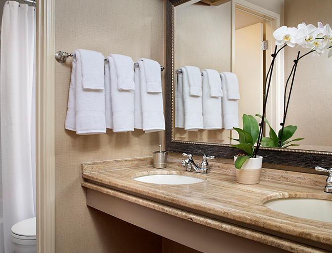 Double sinks with towel rack