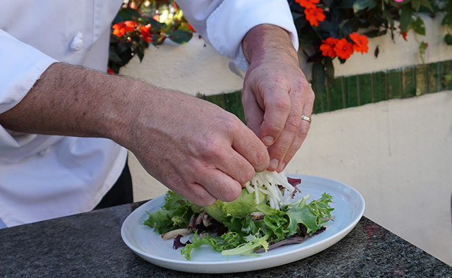 Chef Brett plating the Avocado Salad