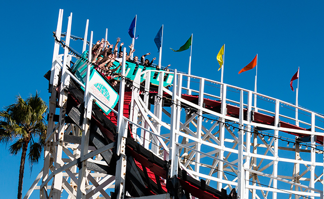 Summer bucket list: People riding the wooden coaster at Belmont Park, San Diego