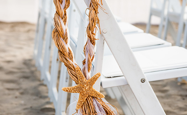 Starfish decor on chair at Beach Wedding