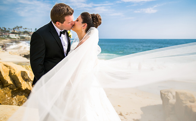 Bride and Groom kissing at their Beach Wedding