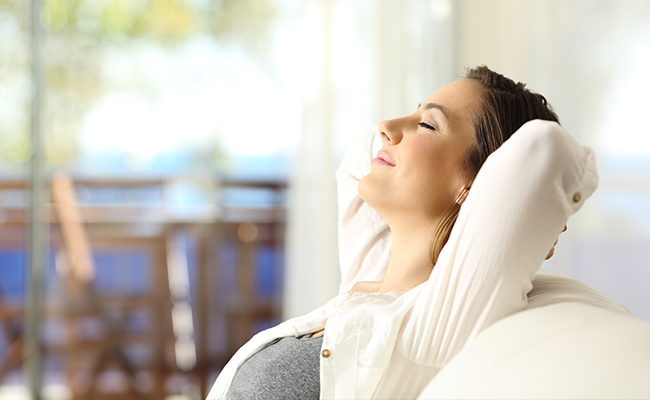 Young woman sitting back relaxing before big day