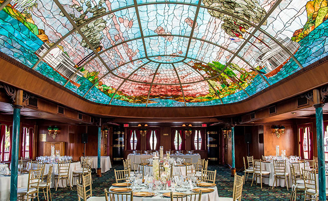 Sternwheeler interior highlighting stain glass ceiling on Mission Bay