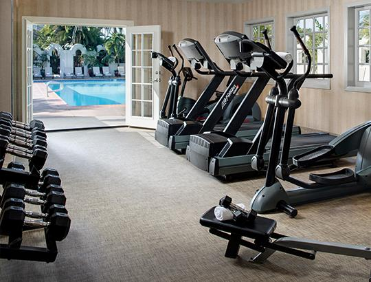 Bahia Resort Fitness Center with views of the pool and garden
