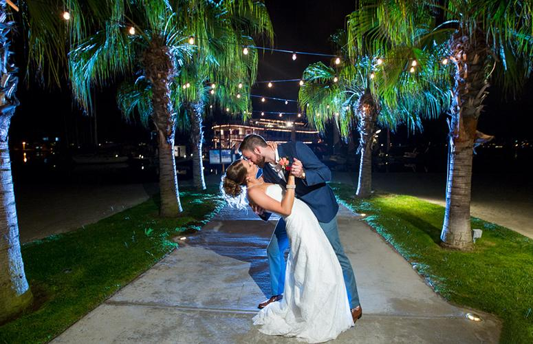 Wedding couple embracing under the stars on Mission Bay